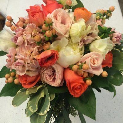 Orange ranuncules, white peonies, blush garden roses