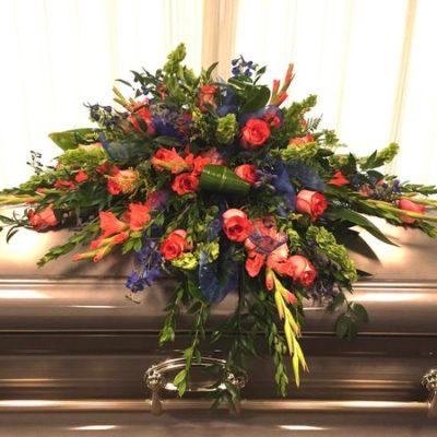 Wright Flower Company Orange roses and Dark Blue Delphinium