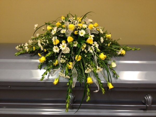 yellow and white casket spray wright flower company