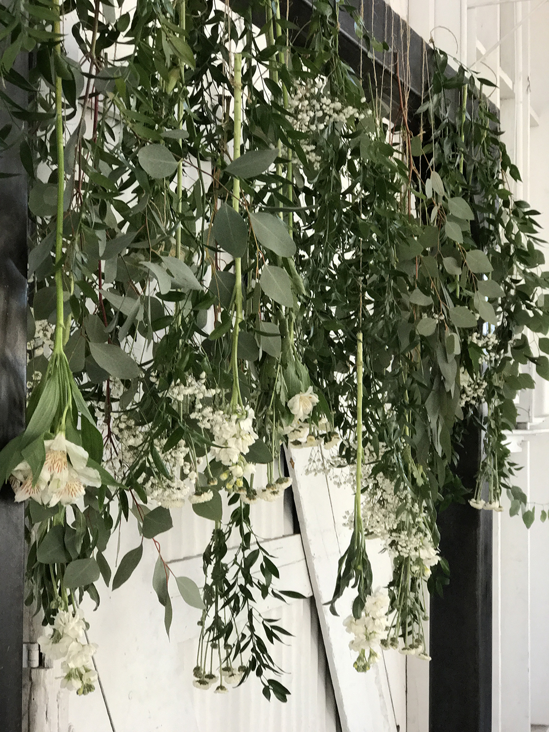 Wright flower company flower delivery in springville utah eucalyptus and italian ruscus arch izmirmasajfo Images